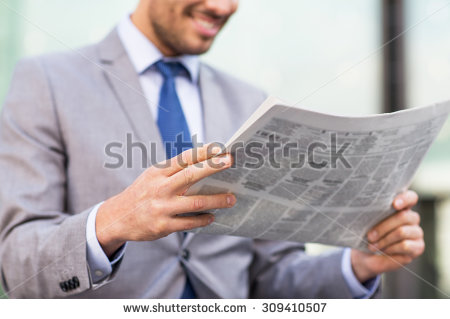 stock-photo-business-press-news-and-people-and-concept-close-up-of-young-smiling-businessman-reading-309410507